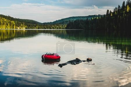 GASPESIE, CANADA - JULY 20, 2017: Couple Floating and Relaxing on this Beautiful Lake after Freeding Session.
