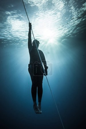 SAN ANDRES ISLAND, Colombia - Circa March 2017: Freediver Diving and Following the Life Line at all time in the Deep Blue of San Andres Island, Colombia.