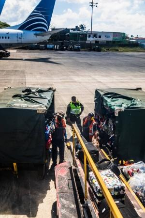 SAN ANDRES ISLAND, Colombia - Circa March 2017: Luggages Loading into the San Andres Caribbean Airpprt