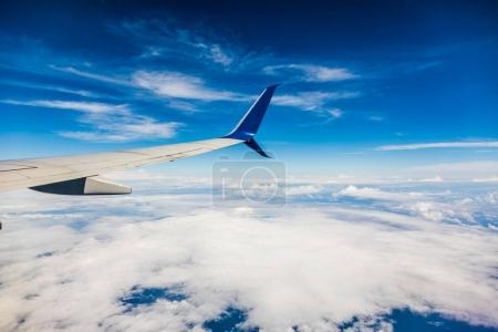 SAN ANDRES ISLAND, Colombia - Circa March 2017: Air Transat Jet wing and white cloudscape in blue sky from window of airplane.