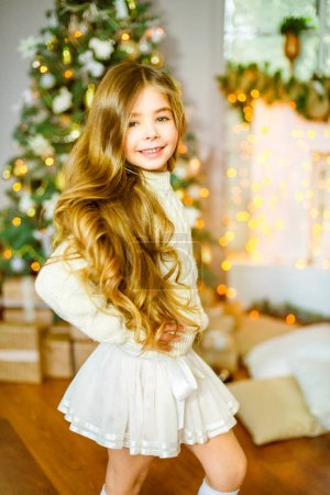 beautiful little girl  in christmas decorated room