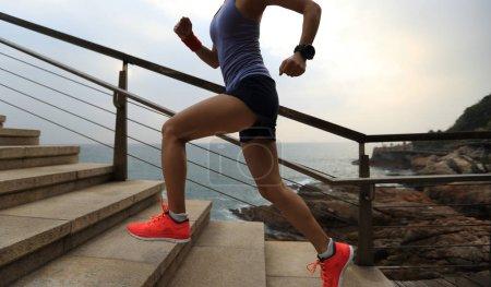 woman  trail runner running on seaside