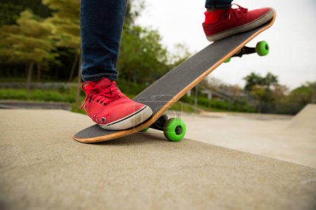 skateboarder legs practicing outdoors