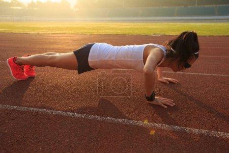woman practicing push ups