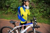young woman cyclist wearing helmet