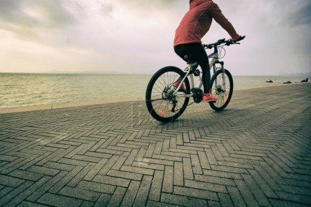 Young woman riding bike