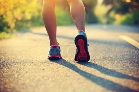 female legs in sport shoes