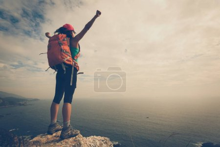 Young woman hiker with open arms