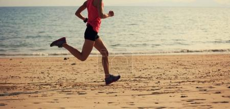 young woman running at beach