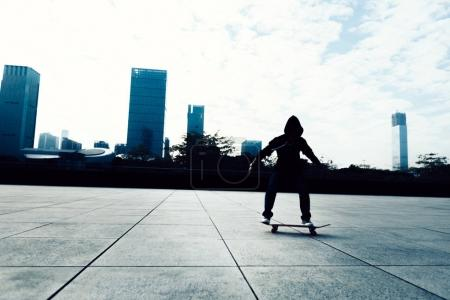 one skateboarder riding with skateboard on city