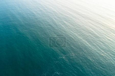 aerial drone view of seascape under sunrise as a background