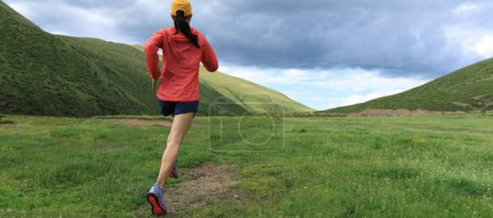 Photo for Young fitness woman trail runner running outside - Royalty Free Image