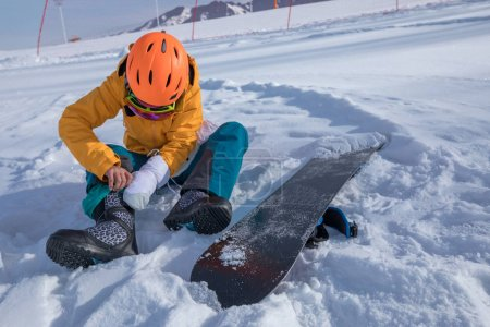 one young woman ready for snowboarding in winter mountains