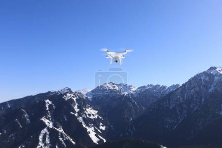 drone flying  over winter mountain top
