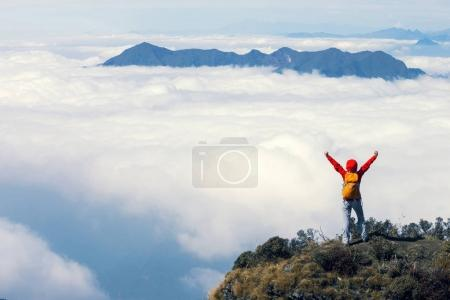 Photo for Successful hiker with arms outstretched on mountain - Royalty Free Image