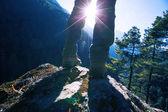 Successful hiker enjoying the sunrise in the himalaya mountains