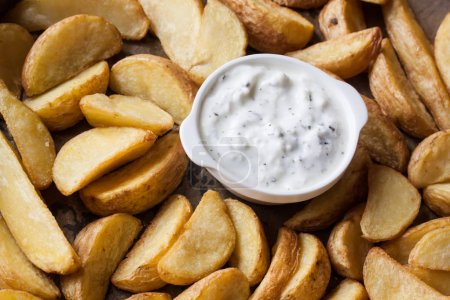 Photo for Baked finger potatoes with yogurt - Royalty Free Image