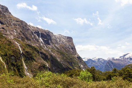 Photo for Panorama with a small rock on a background of blue sky on the road in Fiordland. South Island, New Zealand - Royalty Free Image