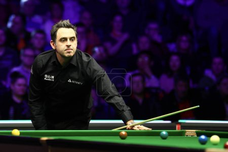 Photo pour Ronnie O'Sullivan of England plays a shot to Stuart Carrington of England at the second round of 2020 Welsh Open in Cardiff, the United Kingdom, 12 February 2020 - image libre de droit