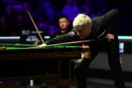 Photo pour Kyren Wilson of England plays a shot to Neil Robertson of Australia at the quarter final of 2020 Welsh Open in Cardiff, the United Kingdom, 14 February 2020 - image libre de droit