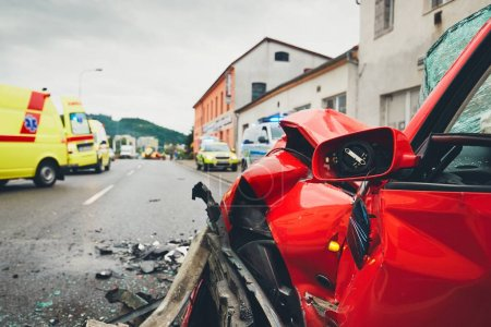 Photo for Close-up view at a crashed car. Teams of the Emergency medical service are responding to an traffic accident. - selective focus - Royalty Free Image