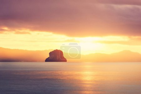 Photo for Amazing sunrise on the sea. Silhouette tropical island in Thailand. - Royalty Free Image
