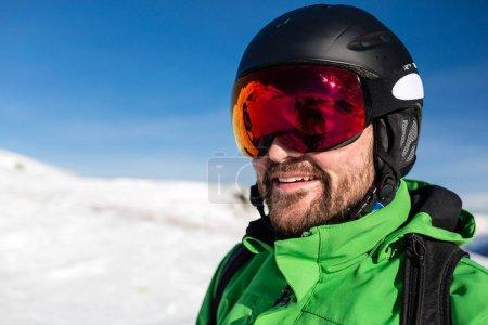 Happy skier with large oversized ski goggles