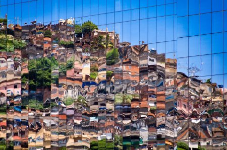 Reflection of Brazilian Slum in Windows of New Building
