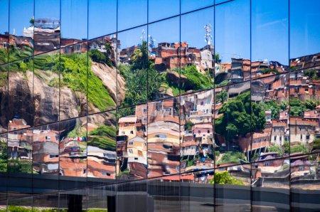 Reflection of Brazilian Slum in Windows of New Building
