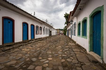 People on the cobblestone streets of Paraty