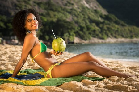 Woman in Bikini with Coconut Drink at the Beach