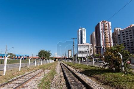 Railway next to skyscrapers