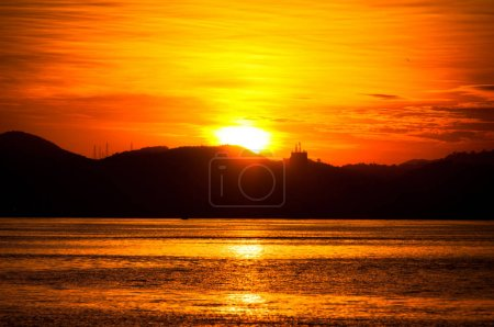 Scenic view of mountains silhouette at gorgeous sunset