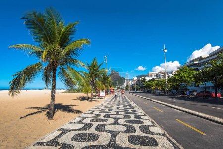 Famous Ipanema Sidewalk Mosaic and Ocean in the Horizon, Rio de Janeiro, Brazil
