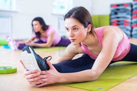 Woman doing cross split exercise