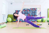 Fit woman doing plank core exercise