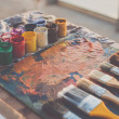 Painter workplace. Palette with brushstrokes and p...