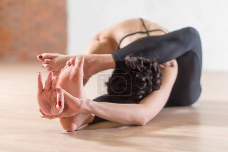 Woman doing yoga meditation and stretching exercise