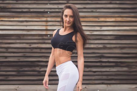Fashion portrait of a young athletic fit girl