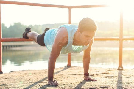 Fit man doing push-ups