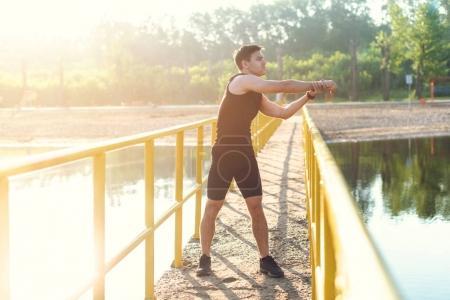 Jogger warming up exercising