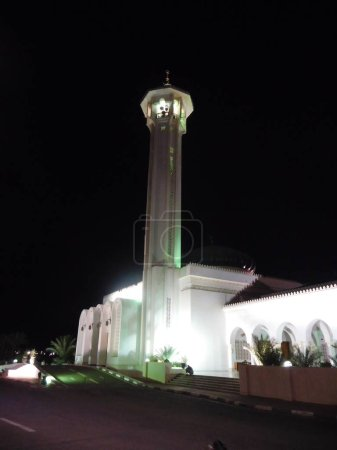 Photo for Tourists visit mosque at night - Royalty Free Image