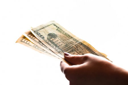 Woman hand giving money like bribe or tips isolated on white bac