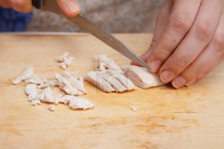 Food preparation -  cutting boiled chicken breast ...