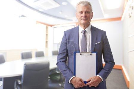 businessman holding  clipboard
