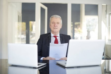 Financial director sitting at desk and working