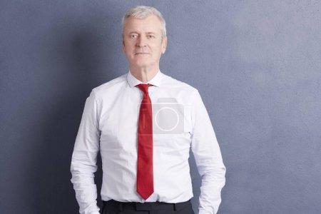 senior businessman standing