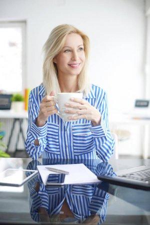 businesswoman having coffee