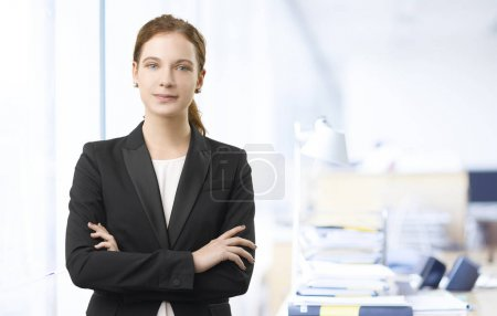 assistant standing in the office
