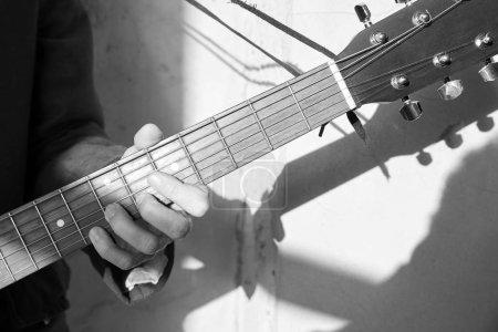 musician strumming his guitar.